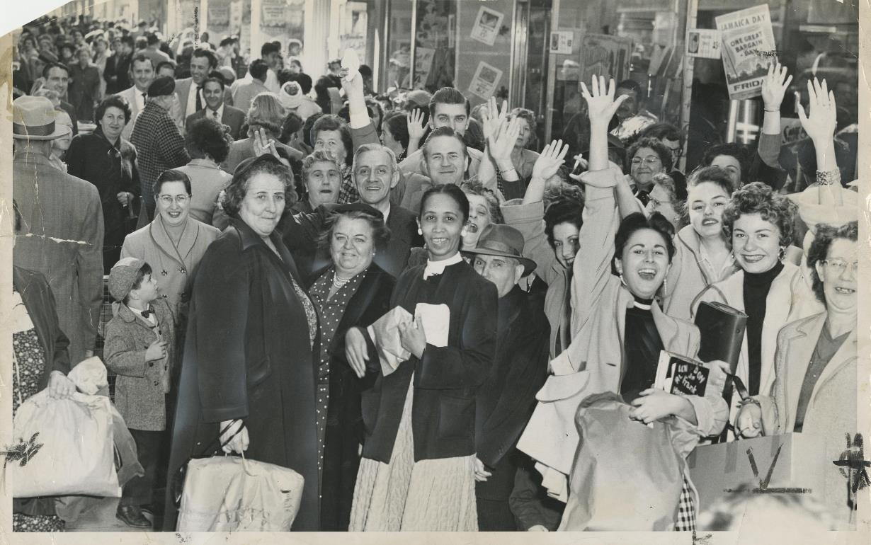 Lots of shoppers look happy to be on Jamaica Avenue during the Jamaica Day sales in October 1957.