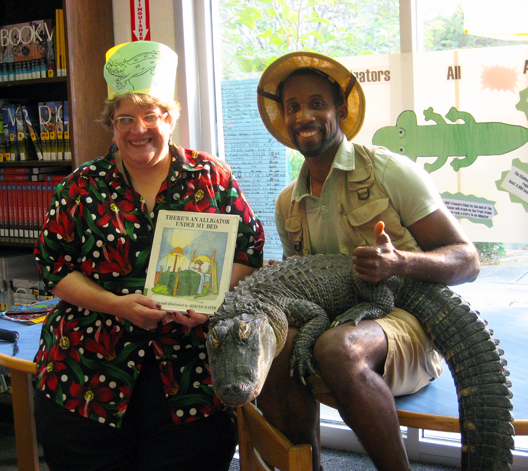 "Susan Scatena with Erik ""The Reptile Guy"" Callender in 2013."