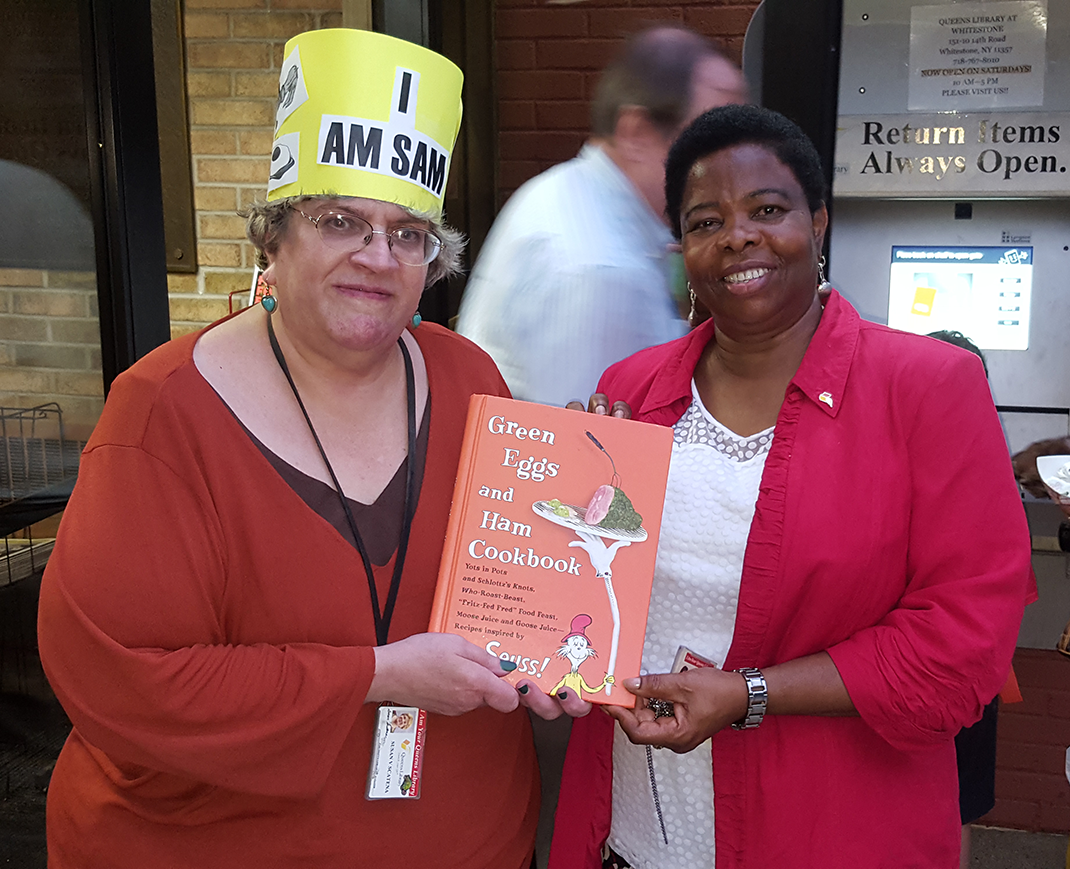 Susan Scatena with Whitestone Library manager Nonyem Iloabachie in 2016.