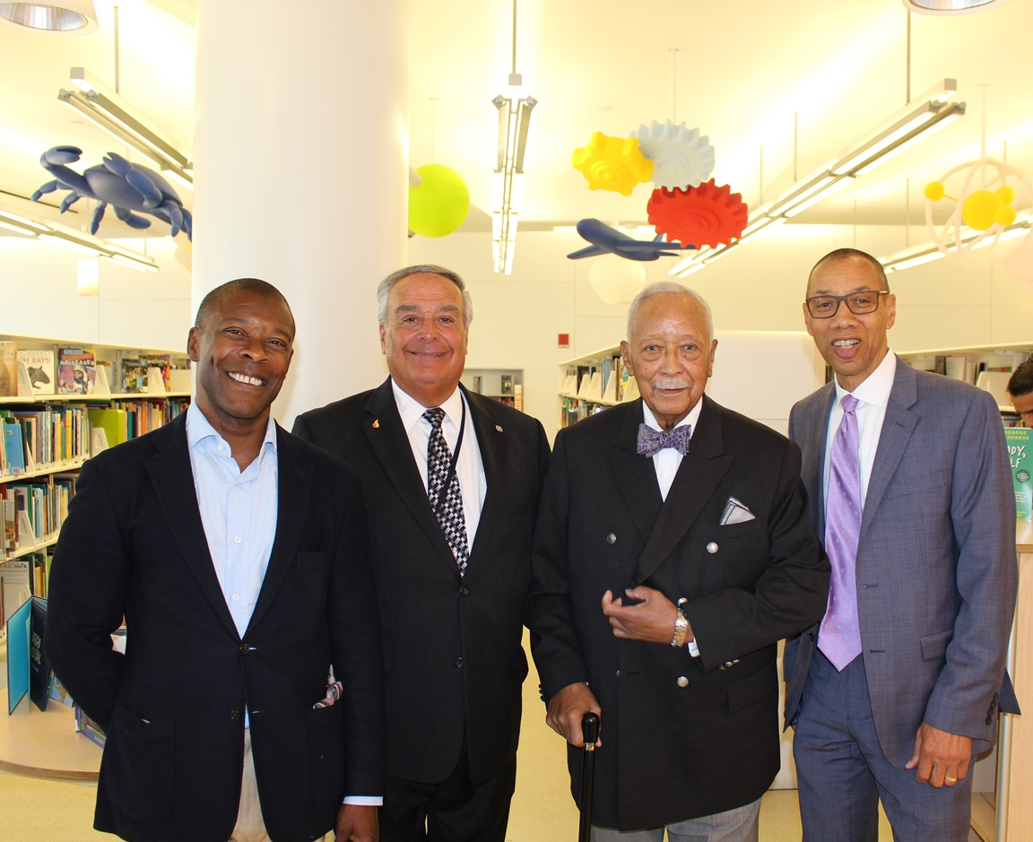Google's Head of External Affairs for New York, William Floyd, with Queens Library Trustee the Honorable Augustus C. Agate, Mayor David Dinkins, and Queens Library President and CEO Dennis M. Walcott.